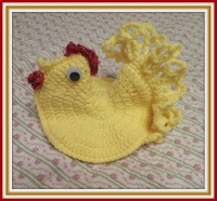 Bright Yellow Chicken with Full Tail Feathers
