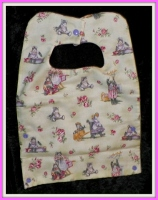 Baby bib lined in flannel with kitties or cats on it